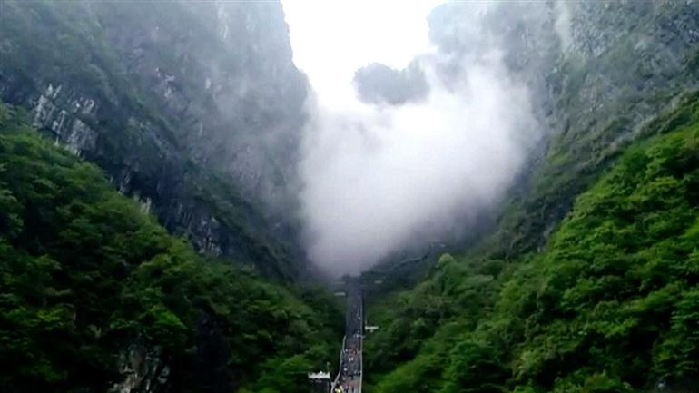 fog-passed-through-the-tianmen-cave-in-the-tianmen-mountain